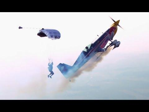 Amazing - Airplane Hovers Beside The Parachutist