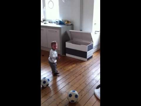Kids - Cute little kid kicking soccer ball into the box