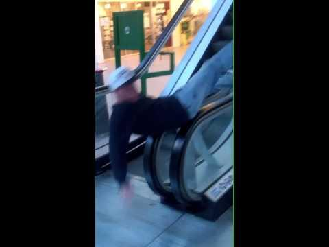 FAIL - Escalator Body Spin Stunt FAIL