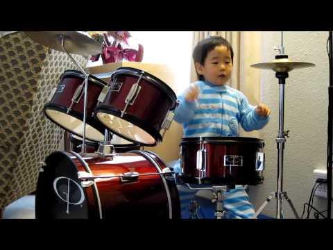 Cute - 2 Years Old Kid Tries To Plays The Drums