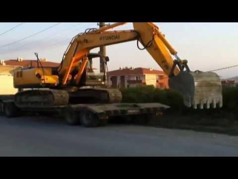 Truck Gets Powered By An Excavator In Russia