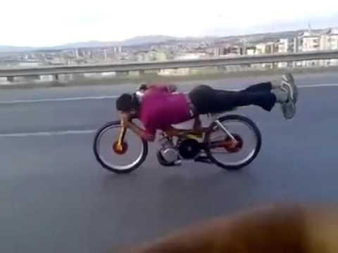 Crazy - Guy Planking On A Mobylette At 140KMH