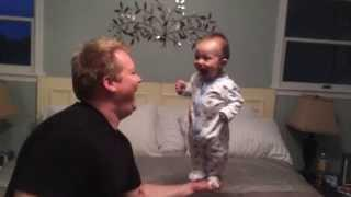 Dad Balances His Baby On One Hand