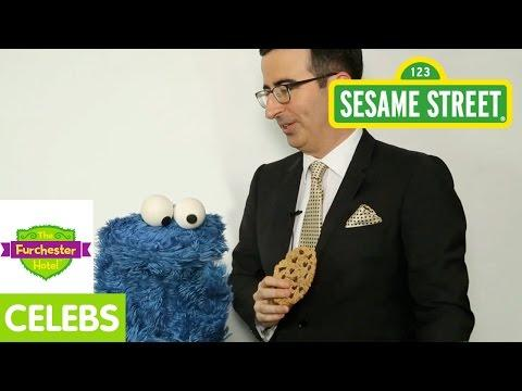 Cookie Monster And John Oliver Talk About Biscuits
