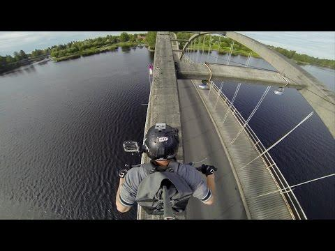 Crazy Guy Rides His Motorcycle On Top Of The Bridge