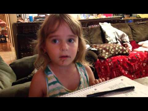 Adorable Little Girl's Reaction To Getting Caught Eating Chocolate Donut