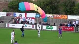 Parachutist Lands On The Soccer Field During Game Between Salisbury City FC and Chester City FC