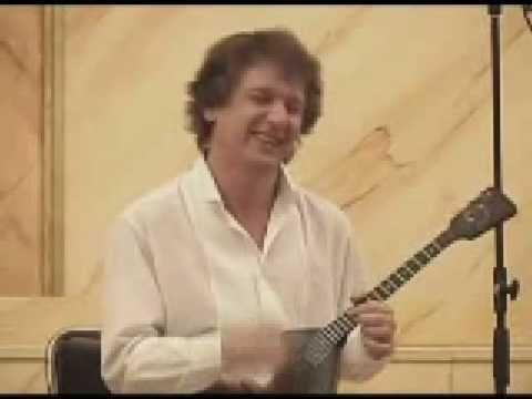 Alexei Arkhipovskiy Playing Sharmanka On The Balalaika