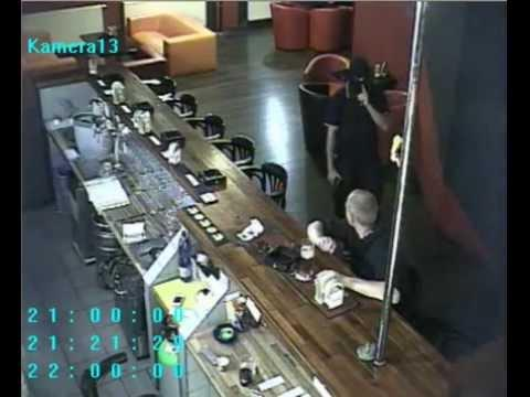 Guy Smokes And Drinks While Bar Gets Robbed
