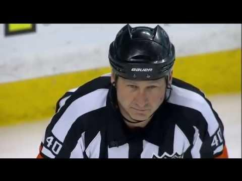 Referee's Face Meets The Puck During Boston Bruins Vs Detroit Red Wings Game