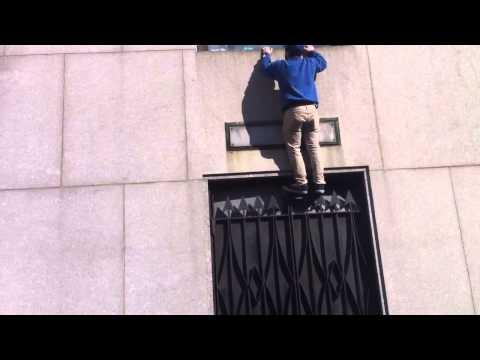 FAIL - New York Giants Fan Tries To Climb A Building