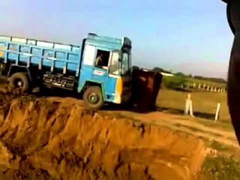 FAIL - Truck Driver Flips His Truck