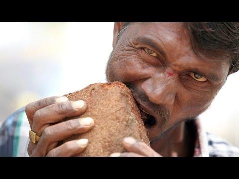 Crazy Man Eats Brick And Dirt