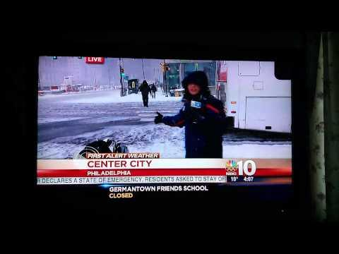 Guy Slips And Falls During Live Weather Report - FAIL