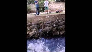 Kid Jumping Over The River FAIL