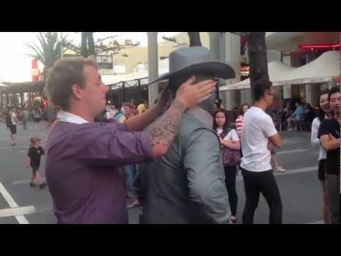 FAIL - Guy Picks On The Wrong Street Performer