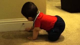Baby Boy Loves The Door Stopper