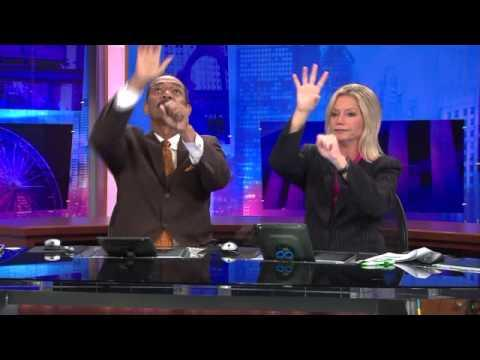 Funny Handshake By WGN-TV Anchors Robert Jordan And Jackie Bange