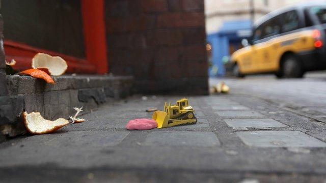 Tiny Bulldozer Tries To Clean The Street