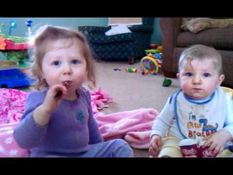 Cute - Baby Girl Feeds Her Baby Brother